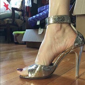 Metallic snakeskin heel