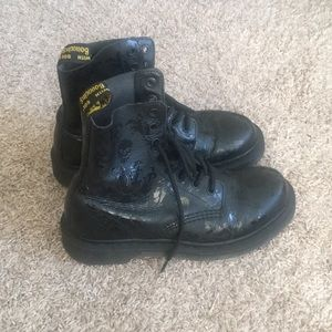 Dr. Martens Cassidy 8-eye boots with skull pattern