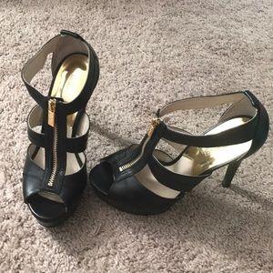 Michael Kors Black high heels with gold zipper