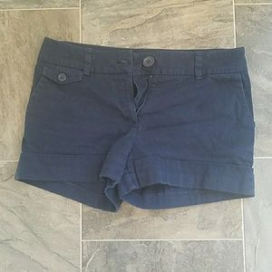 Navy blue shorts.