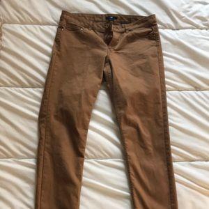 Dark tan, skinny pants.