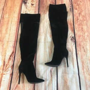 Black over the knee pointy high heel boots