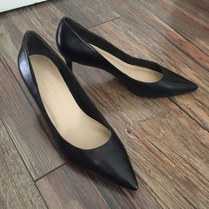 Classic black medium height pointed toe heels