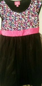 Girls beautiful sz 6 sequins & black dress below k