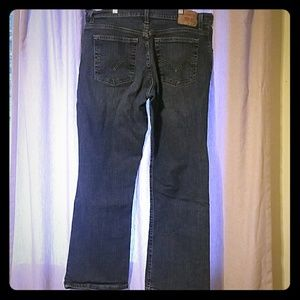 Levis 550 relaxed boot cut jeans 14s 14 short