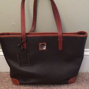 Dooney and Bourke brown and camel colored purse.