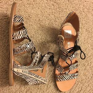 Black and white gladiator sandals
