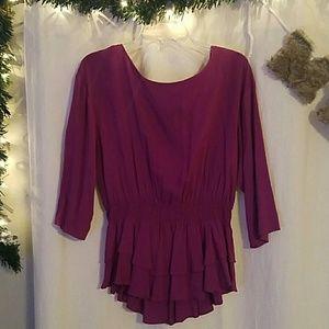 Purple three quarter sleeve ruffle top