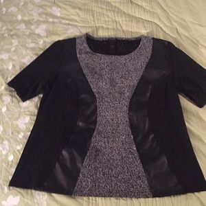 Black and faux leather blouse