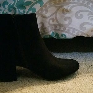 Pair of size 8 black booties.