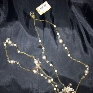Long pearl/bow necklace