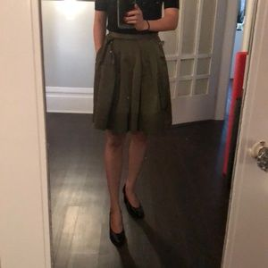 Green satin skirt with pockets and pleats