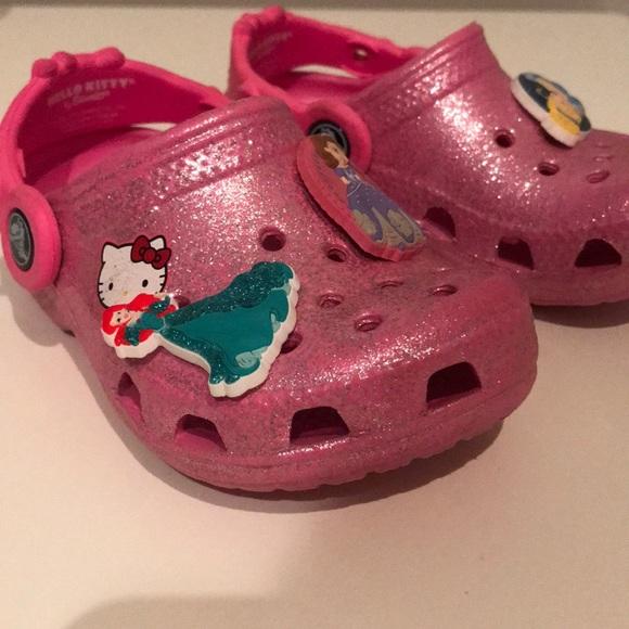 fce2b755948 CROCS Other - Pink glitter hello kitty crocs   princess charms