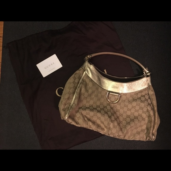 87671765a11 Gucci monogram large D Gold shoulder bag. Gucci.  M 5a2dd7e8f739bc8dca013f71. M 5a2dd7e9680278cf7a013a12.  M 5a2dd7eafbf6f906700140f4