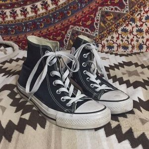 Black and white hightop converse