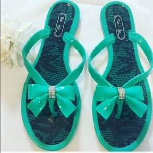 Shoes - Turquoise jelly beach flip flops with bow.