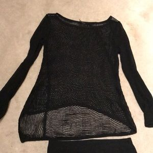 Asymmetrical see through top with knitted skirt.