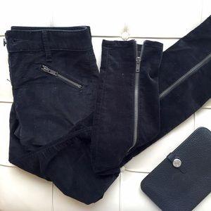 Black velvet skinny skimmer pants with zippers