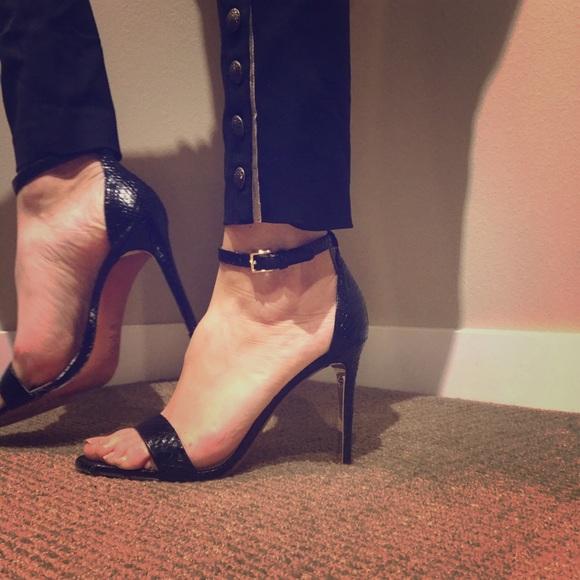 ec56edd70 Tory Burch Black ankle strap Keri Snakeskin sandal.  M 5a2e0aa8bf6df56bfa028ac4
