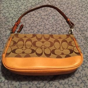 Small brown Coach bag with leather