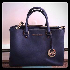 Medium navy blue Micheal Kors satchel
