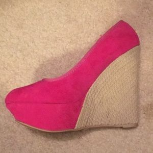 Hot pink wedge pumps