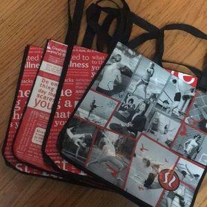 4 large Lululemon shopping bags