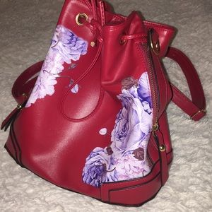 Red mini backpack with floral design