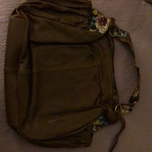 Leather bag with floral lining