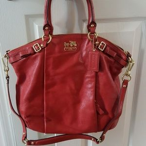 Leather Coach purse with gold detail.
