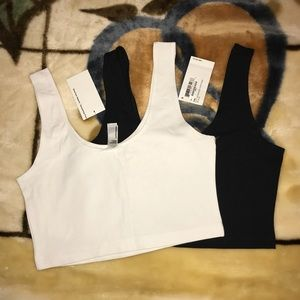 two AA cropped tanks