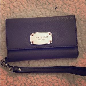 Michael Kors wristlet can hold your phone!!