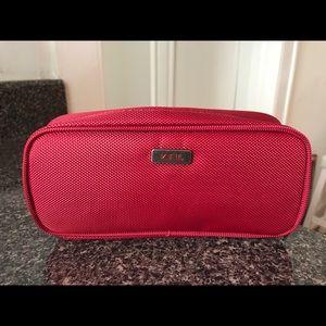 Small TUMI cosmetic case Red
