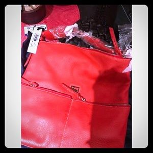 Brand new with tag and storage bag