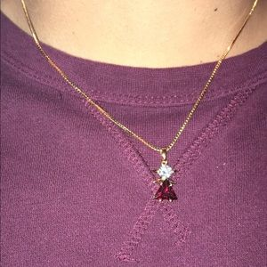 Lifetime guarantee necklace with red pendant