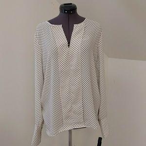 Very elegant white blouse with black polka dots