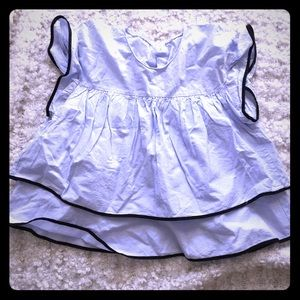 Baby blue tiered top with black trim