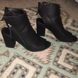 Black peep toe and open back booties