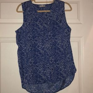 Blue patterned sleeveless blouse