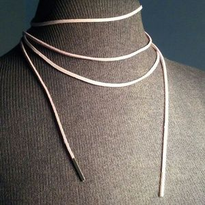 Leather choker with metal tips