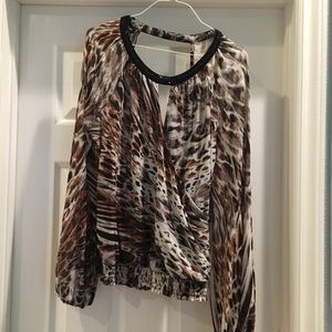 Bebe animal print draped blouse.