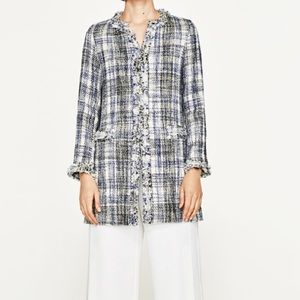 Frayed checked frock coat