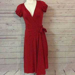 Diane Von Furstenberg wrap around red dress 2