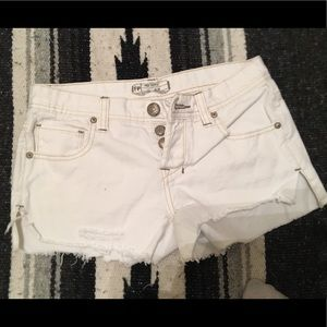 Distressed white Free People shorts- size 24
