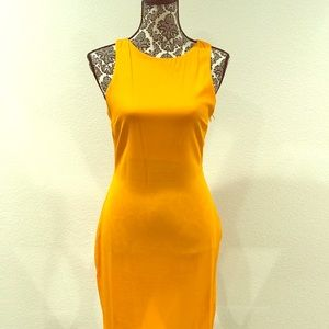 Orange, fitted, cut outs dress.