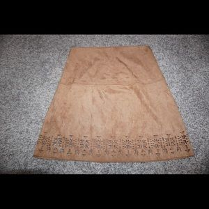 adorable faux suede skirt with cut out detail !