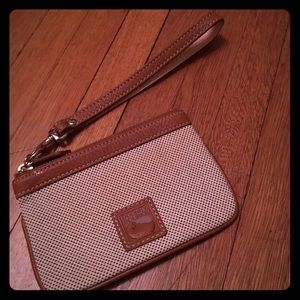 Beautiful beige/ leather Dooney & Bourke wristlet