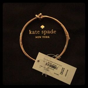 Kate Spade bracelet with holding bag