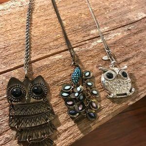Three bird necklaces.