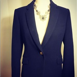 Women's Zara navy blue blazer with gold buttons.